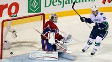 Vancouver Canucks left wing Mason Raymond (not pictured) scores a goal against Montreal Canadiens goalie Carey Price (31) as right wing Jannik Hansen (36) looks on during the second period at the Bell Center in Montreal, Quebec, Canada. (Jean-Yves Ahern-US PRESSWIRE/US PRESSWIRE)