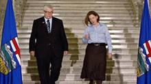 Deputy PremierDaveHancockand Alberta Premier Alison Redford make their way to a press conference to announce Alison Redford's resignation in Edmonton, Alberta on Wednesday March 19, 2014. (THE CANADIAN PRESS/Jason Franson)