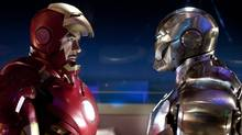 Robert Downey Jr., left, stars as billionaire industrialist Tony Stark, a.k.a. Iron Man, in Iron Man 2. (Francois Duhamel/Francois Duhamel)
