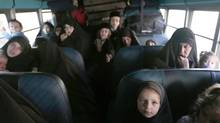 Members of a Jewish community sit on a bus while preparing to leave the village of San Juan La Laguna August 29, 2014. A few months after moving from Canada to a remote part of Guatemala to find religious freedom, a group of ultra orthodox Jews have been forced out of their homes in a bitter conflict with hostile villagers. (JORGE DAN LOPEZ/REUTERS)