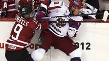 Canada's Mark Scheifele, left, checks Russia's Nail Yakupov in third period action in the Canada-Russia junior hockey challenge in Halifax on Monday, August 13, 2012. Russia won 6-5 and lead the series 2-1. (Andrew Vaughan/THE CANADIAN PRESS)