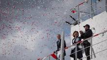 Interim CEO of Seaspan Shipyards Jonathan Whitworth, left, Premier Christy Clark, centre, and executive chairman of Seaspan Kyle Washington were on hand for the commissioning ceremony of two new Seaspan LNG-fuelled vessels in Delta on Sunday. (DARRYL DYCK/THE CANADIAN PRESS)