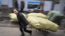 "Yang Bizhi, one of the many ""bang-bang"" in Chongqing who make their living as a porter. (John Lehmann/The Globe and Mail)"