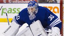 Ben Scrivens follows the play along the boards in the first period of their NHL game in Toronto March 31, 2012. (/Fred Thornhill/Reuters//Fred Thornhill/Reuters)