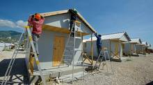Work crews build World Vision transistional housing for earthquake victims outside Port-au-Prince. (Jon Warren/Jon Warren/World Vision)