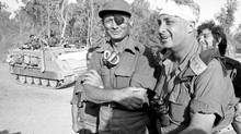 Israeli Prime Minister Ariel Sharon, right, recovering from a head injury, is seen with Moshe Dayan, left, on the western side of the Suez Canal in this October, 1973, handout file photograph from the Israeli Defense Ministry (REUTERS)