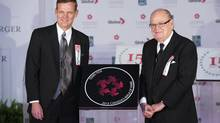 Late cancer research advocate Terry Fox has his star accepted posthumously by his brother Darrell Fox, left, and his father Rolly Fox during Canada's Walk of Fame induction ceremonies in Toronto on Sept. 21, 2013. (MARK BLINCH/REUTERS)