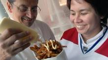 Normand Laprise and Cheryl Johnson, then-sous chef at Toqué!, with french fries in Montreal on May 21, 2010. (John Morstad for The Globe and Mail)