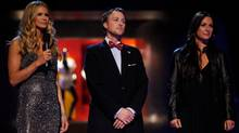 "Host Elle Macpherson (from left), Ross Bennett and Sarah Parrott are shown during the premiere episode of ""Fashion Star."" (Tyler Golden/AP)"