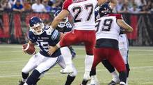 Toronto Argonauts quarterback Ricky Ray has no place to go with his pass as Calgary Stampeders' Jeff Hecht blocks his passing lane during fourth quarter action in their CFL game in Toronto on Saturday. (FRED THORNHILL/THE CANADIAN PRESS)