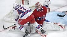 Montreal Canadiens goaltender Carey Price makes a save against New York Rangers' J.T. Miller during second period NHL action in Montreal, Saturday, February 23, 2013. (Graham Hughes/THE CANADIAN PRESS)