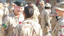 Governor-General David Johnston meets with Canadian troops at Kandahar Airfield in Afghanistan. (Jonathan Montpetit/The Canadian Press)
