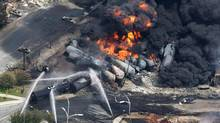 A Quebec coroner says the deaths of 47 people in the July, 2013, Lac-Mégantic rail disaster could have been avoided. (Paul Chiasson/THE CANADIAN PRESS)