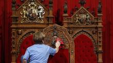 A worker cleans the Senate chamber on Parliament Hill in Ottawa on June 1, 2011. (Chris Wattie/Reuters)