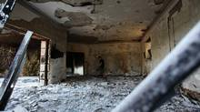 A Libyan man walks in the rubble of the damaged U.S. consulate, after an attack that killed four Americans, including Ambassador Chris Stevens on the night of Tuesday, Sept. 11, 2012, in Benghazi, Libya. (Mohammad Hannon/AP)
