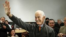 NDP Leader Jack Layton waves to the crowd as he leaves a Quebec City restaurant during a campaign stop on April 18, 2011. (MATHIEU BELANGER/REUTERS)