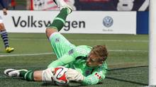 Vancouver FC goalkeeper David Ousted (1) makes a save against the New England Revolution during the first half at Gillette Stadium. (Winslow Townson/USA Today Sports)