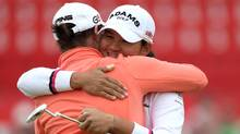 Yani Tseng of Taiwan embraces Caroline Masson of Germany on the 18th green following her victory during the final round of the 2011 Ricoh Women's British Open at Carnoustie Golf Links on Sunday. (Warren Little/2011 Getty Images)