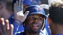 Toronto Blue Jays' Rajai Davis is congratulated in the dugout after scoring on a single by teammate Colby Rasmus in the 12th inning of a baseball game against the Cleveland Indians in Cleveland on Saturday, April 7, 2012. (AP Photo/Amy Sancetta) (Amy Sancetta/AP)