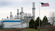 A U.S. flag flies in front of the natural gas fired 1200-megawatt Kendall Energy power plant, owned by Dynegy Inc., in Minooka, Ill., in this file photo. (Daniel Acker/Bloomberg)
