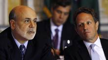 U.S. Secretary of the Treasury Timothy Geithner, right, listens to Federal Reserve chairman Ben Bernanke, left, at the Treasury Department for the meeting of the Financial Stability Oversight Council in Washington, Nov. 13, 2012. (Gary Cameron/Reuters)