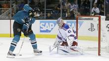 Tomas Hertl scores his fourth goal of the game on Tuesday past New York Rangers goalie Martin Biron. The goal involved some fancy moves, not all of which are drawing praise from around the NHL.<240> (MARCIO JOSE SANCHEZ/AP)