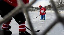 Seven year old Jack DeRabbie shoots the puck at the net after a press conference at Toronto's Trinity Bellwoods ice rink on Feb. 27, 2014. (Fred Lum/The Globe and Mail)