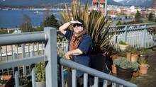 Derek Andrews stands on the rooftop of the Four Sisters Housing Co-op in Vancouver. (Jimmy Jeong for The Globe and Mail)