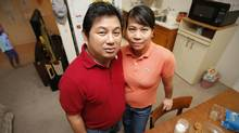 Recent philippine immigrants Mike Villanueva and his wife Lorna are photographed in their Winnipeg apartment with their five year old daughter Mica Thursday, March 17, 2011. (JOHN WOODS For The Globe and Mail)