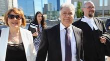 London Mayor Joe Fontana walks to the London, Ont., courthouse with his wife, Vicky, on the first day of his fraud trial on May 26, 2014. (DAVE CHIDLEY/THE CANADIAN PRESS)