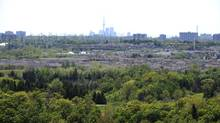 Downtown Toronto and the CN Tower are visible from a high vantage point in Rouge Park on May 17, 2012. (Fred Lum/Fred Lum/The Globe and Mail)