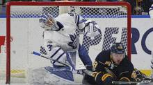 Buffalo Sabres forward William Carrier (48) collides with Toronto Maple Leafs goalie Frederik Anderson (31) during the first period of an NHL hockey game, Saturday, March 25, 2017, in Buffalo, N.Y. (Jeffrey T. Barnes/AP)