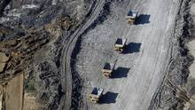 Suncor Energy Inc. is working to replace its fleet in the oil sands with autonomous trucks 'by the end of the decade.' (Ben Nelms/Bloomberg)