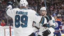San Jose Sharks' Mikkel Boedker and Melker Karlsson celebrate a goal during the first period. (JASON FRANSON/THE CANADIAN PRESS)