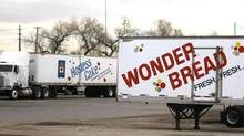 Trucks are parked at the closed Hostess plant in Denver on Nov. 19, 2012. (RICK WILKING/REUTERS)