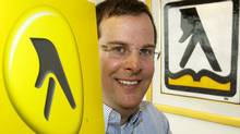 Marc Tellier, chief executive of Yellow Media Inc., formerly Yellow Pages, shows the company's new logo at their head office Monday, March 22, 2010 in Montreal. (Ryan Remiorz)