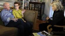 U.S. Rep. Gabrielle Giffords, center, and husband Mark Kelly are interviewed by Diane Sawyer, right, on ABC's 20/20. (Ida Mae Astute/AP Photo/ABC, Ida Mae Astute)