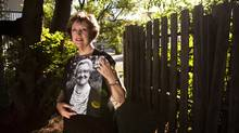 Joyce Western poses with a portrait of her late mother, Marjorie Howse, in St. Catherines, Ont. Sunday, July 3, 2011.Ms. Howse, was admitted to St. Catharines General Hospital on May 18 with pneumonia. Shortly after, she began showing symptoms of C. difficile. (Darren Calabrese for The Globe and Mail/Darren Calabrese for The Globe and Mail)