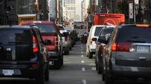 Morning traffic heading north on Yonge St. near King St. in downtown Toronto on August 24, 2012. (Fred Lum/The Globe and Mail)