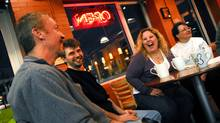 From left, Scott Lacey, 43, and Brent Bauman, 39, joke as Lori Spurgeon, 36, laughs next to Ann-Marie Neufeld, 48, during a meetup meeting between over-30-singles in Cambridge, Ont. on Monday March 19, 2007. Bauman wanted to meet people for coffee or fun nights out. But where? He found the answer on Meetup.com. (Mathew McCarthy/CP PHOTO/Waterloo region record)