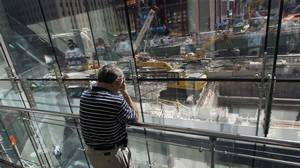John Blossom of Connecticut rests his head in his hand in quiet contemplation across from the site of the former twin towers on the ninth anniversary of the 9/11 attacks on the World Trade Center in New York, September 11, 2010.