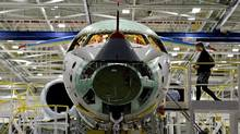 By cementing new investments and product mandates, and supporting domestic high-tech exporters, like Bombardier, the government would make a much bigger difference to Canada's revitalized 'value-added' exports than by barking up more free-trade trees. (Nathan Denette/THE CANADIAN PRESS)