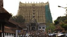 Devotees throng to Sree Padmanabhaswamy temple after offering prayers on the eve of Pongala festival in Thiruvananthapuram, capital of the southern Indian state of Kerala February 18, 2011. (Reuters/Reuters)