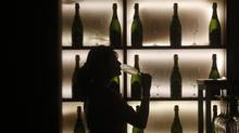 A woman poses with a glass of wine at a tapas bar in Mumbai March 9, 2013. Women who drink, while still wary of entering most watering holes, are becoming big business in socially conservative India. (VIVEK PRAKASH/REUTERS)