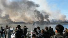 This picture taken on November 23, 2010 by a South Korean tourist shows huge plumes of smoke rising from Yeonpyeong island in the disputed waters of the Yellow Sea on November 23, 2010. North Korea fired dozens of artillery shells onto a South Korean island on November 23, 2010, killing two people, setting homes ablaze and triggering an exchange of fire as the South's military went on top alert. (AFP/Getty Images/AFP/Getty Images)
