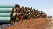 Miles of unused pipe intended for the stalled Keystone XL pipeline are stacked in a field near Ripley, Okla., in February, 2012. Fulfilling a campaign promise, U.S. President Trump has approved the completion of the delayed pipeline with some caveats intended to favour his country's work force and manufacturing industry. (Sue Ogrocki/THE ASSOCIATED PRESS)