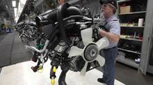 Chrysler Group assembly staff works on the engine of a 2014 Dodge Ram pickup truck at the Warren Assembly Plant in Warren, Michigan December 11, 2013. (REBECCA COOK/REUTERS)