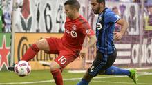 Montreal defender Victor Cabrera and TFC forward Sebastian Giovinco battle for the ball during Sunday's game in Montreal. (Eric Bolte/USA Today Sports)