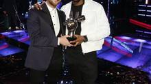 Josh Kaufman, left, poses with his trophy with Usher after the 38-year-old from team Usher was crowned the season six winner of NBC's The Voice. (NBC/THE ASSOCIATED PRESS)