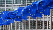 European Union flags are seen outside the European Commission headquarters in Brussels. (YVES HERMAN/REUTERS)